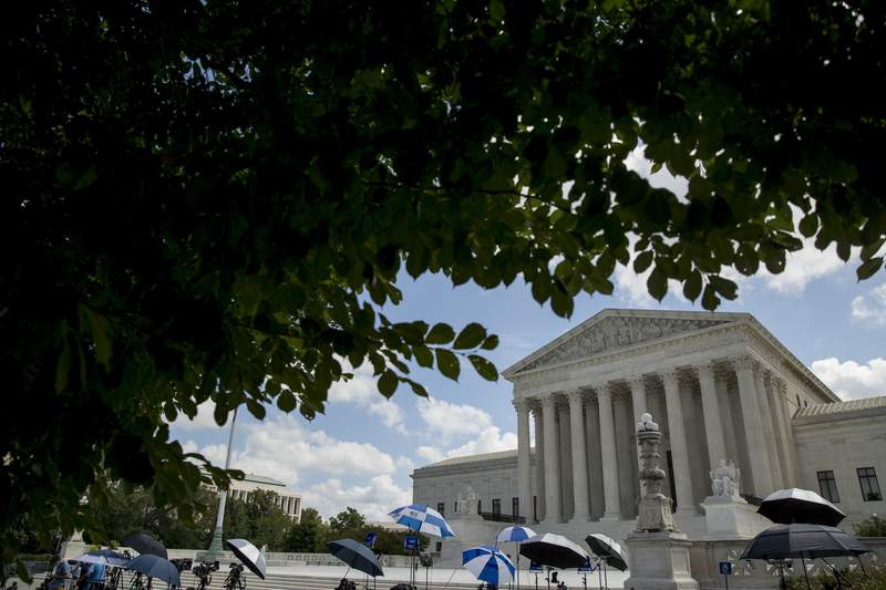 Members of the media set up outside the Supreme Court, Thursday, July 9, 2020, in Washington. The Supreme Court ruled Thursday that the Manhattan district attorney can obtain Trump tax returns while not allowing Congress to get Trump tax and financial records, for now, returning the case to lower courts. (AP Photo/Andrew Harnik)