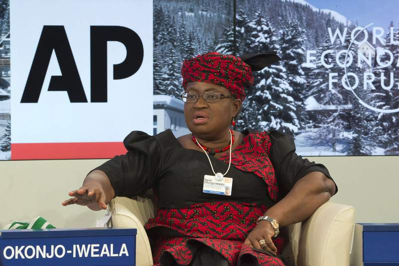"""FILE - In this Friday, Jan. 24, 2014 file photo, Nigerian Finance Minister Ngozi Okonjo-Iweala during a panel discussion """"The Post-2015 Goals: Inspiring a New Generation to Act"""", the fifth annual Associated Press debate, at the World Economic Forum in Davos, Switzerland. Okonjo-Iweala was appointed Monday, Feb. 15, 2021 to head the World Trade Organization as it seeks to to resolve disagreements over how it decides cases involving billions in sales and thousands of jobs. Okonjo-Iweala was appointed as director-general of the leading international trade body by representatives of the 164 member countries, according to a statement from the body. (AP Photo/Michel Euler, file)"""