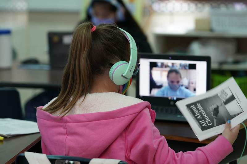 Students at Driggers Elementary School attend a class in-person as they interact with classmates virtually, Monday, Feb. 8, 2021, in San Antonio. After seeing two academic years thrown off course by the pandemic, school leaders around the country are planning for the possibility of more distance learning next fall at the start of yet another school year. (AP Photo/Eric Gay)