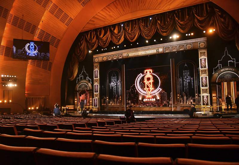 FILE - A view of the stage appears prior to the start of the 73rd annual Tony Awards at Radio City Music Hall in New York on June 9, 2019. Tony Award Productions said Friday that the celebration of live theater will be digital but offered no date or streaming platform. Final eligibility determinations will be made by the Tony Awards Administration Committee in the coming days. Broadway theaters abruptly closed on March 12, knocking out all shows  including 16 that were still scheduled to open. (Photo by Charles Sykes/Invision/AP, File)