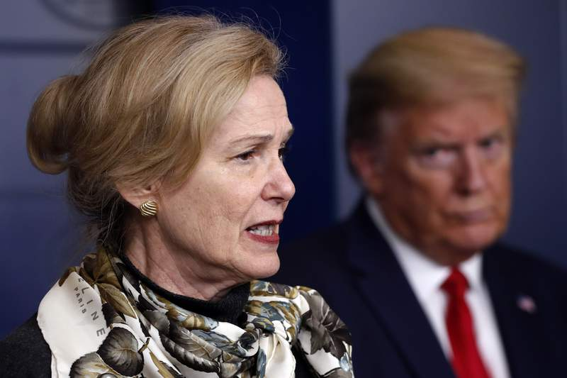 FILE - In this April 22, 2020, file photo, President Donald Trump listens as Dr. Deborah Birx, White House coronavirus response coordinator, speaks about the coronavirus in the James Brady Press Briefing Room of the White House in Washington. Birx was brought into President Donald Trumps orbit to help fight the coronavirus, she had a sterling reputation as a globally recognized AIDS researcher and a rare Obama administration holdover. Less than 10 months later, her reputation is frayed and her future in President-elect Joe Biden's administration uncertain. (AP Photo/Alex Brandon, File)