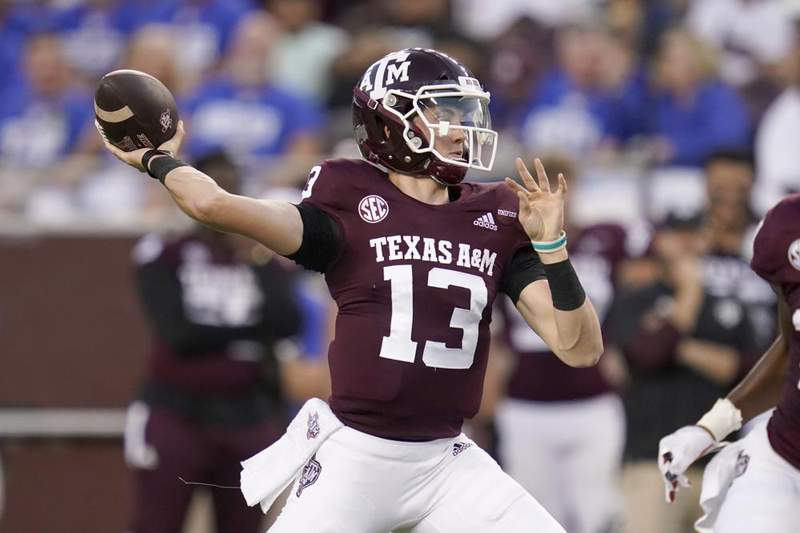 Texas A&M quarterback Haynes King (13) passes downfield against Kent State during the first half of an NCAA college football game on Saturday, Sept. 4, 2021, in College Station, Texas.