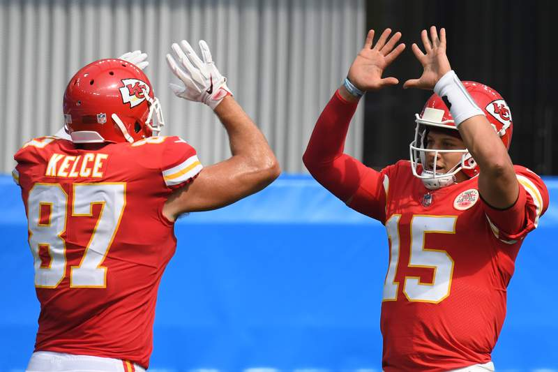 INGLEWOOD, CALIFORNIA - SEPTEMBER 20: Quarterback Patrick Mahomes #15 of the Kansas City Chiefs celebrates a touchdown by  teammate tight end Travis Kelce #87 against the Los Angeles Chargers during the second quarter at SoFi Stadium on September 20, 2020 in Inglewood, California. (Photo by Harry How/Getty Images)