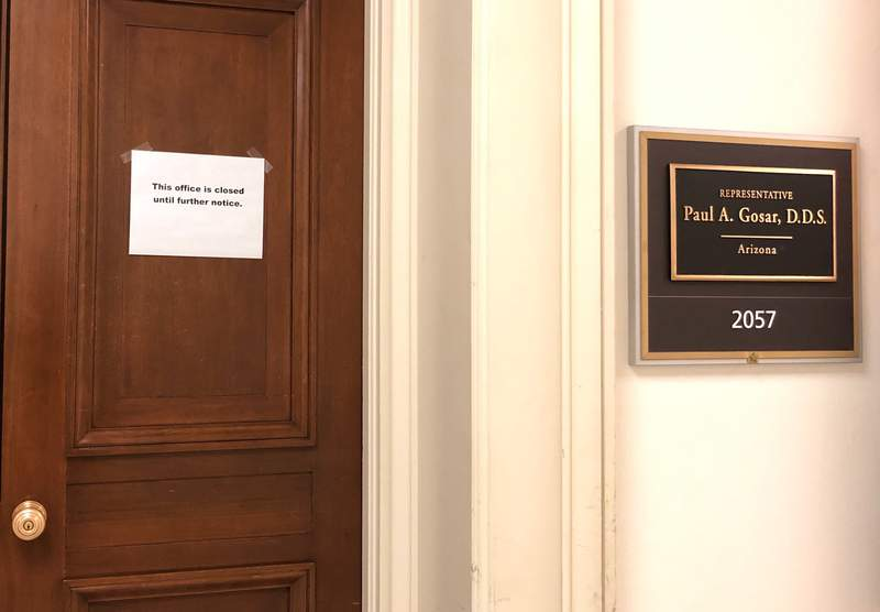 """The Capitol Hill office door of Rep. Paul Gosar, R-Ariz., has a sign that reads, """"This office is closed until futher notice,"""" shown Monday, March 9, 2020 on Capitol Hill in Washington.  On Sunday, Sen. Ted Cruz, R-Texas, and Gosar said they're isolating themselves after determining they had contact with a person at a Maryland political conference who got COVID-19.  (AP Photo/Padmananda Rama)"""