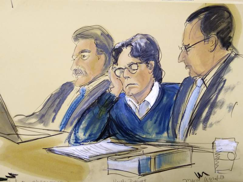 FILE - In this June 18, 2019 courtroom artist's sketch, defendant Keith Raniere, center, sits with attorneys Paul DerOhannesian, left, and Marc Agnifilo during closing arguments at Brooklyn federal court in New York.   Raniere and his lawyers filed a motion Monday, March 9, 2020 for a new trial, arguing that two witnesses perjured themselves when they denied they were planning to sue him after the trial. A jury convicted Keith Raniere in June on all counts of sex-trafficking and coercing women into sex.  (Elizabeth Williams via AP, File)