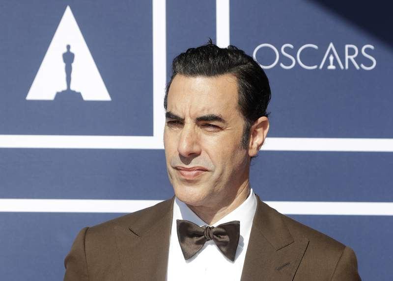 FILE - In this April 26, 2021 file photo, Sacha Baron Cohen arrives to attend a screening of the Oscars in Sydney, Australia. The actor has sued a Massachusetts cannabis dispensary he says used an image of his character Borat on a billboard without his permission. (AP Photo/Rick Rycroft, File)