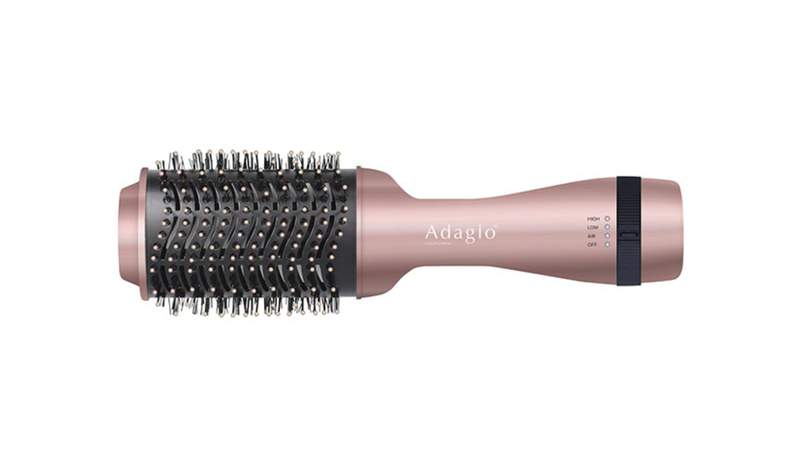 Bring the salon experience to your home with this 2-in-1 hair brush dryer.