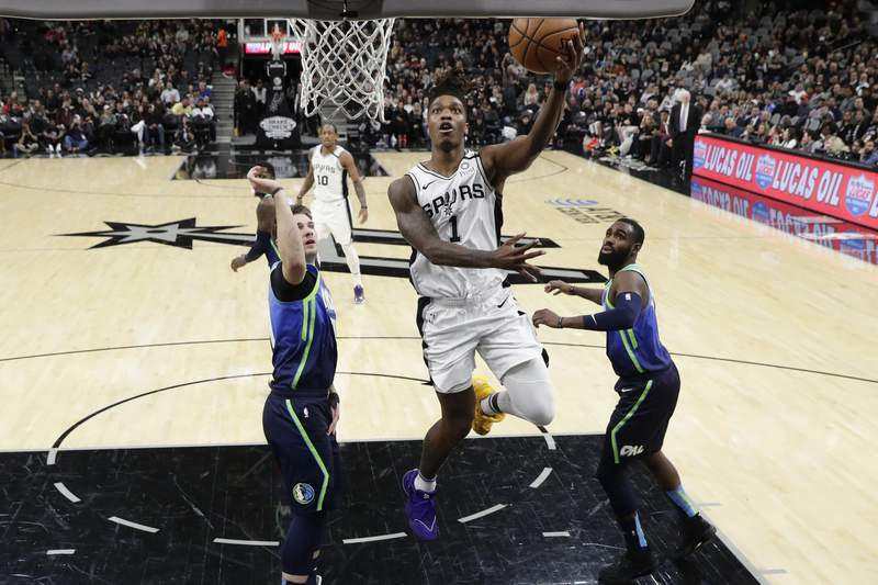 Spurs guard Lonnie Walker IV (1) scores against the Dallas Mavericks during an NBA game on Feb. 26, 2020. (AP Photo/Eric Gay)