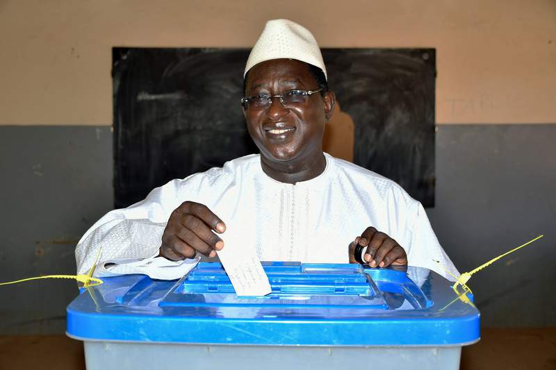 FILE - In this Aug. 12, 2018 file photo released by the Union for the Republic and Democracy party shows then opposition Presidential candidate Soumaila Cisse casting his ballot during the presidential second round election in Niafunke, Mali. Malian opposition leader Soumaila Ciss, who was held hostage for six months by jihadists and considered a leading contender for 2022 elections, has died in Paris, his family said Friday. (Boubacar Sada Sissoko/Union for the Republic and Democracy via AP, File)
