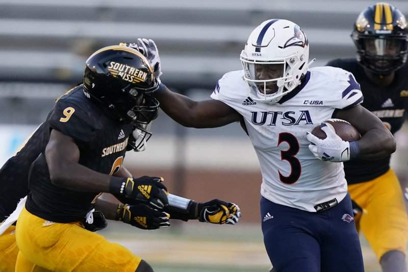 UTSA running back Sincere McCormick (3) runs past Southern Mississippi linebacker Hayes Maples (32) for a first down during the second half of an NCAA college football game, Saturday, Nov. 21, 2020, in Hattiesburg, Miss. UTSA won 23-20.