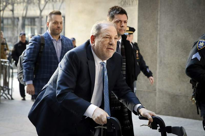 In this Feb. 24, 2020, file photo, Harvey Weinstein arrives at a Manhattan courthouse as jury deliberations continue in his rape trial in New York. A Delaware judge has approved a revised Weinstein Co. bankruptcy plan that provides about $35 million for creditors, with roughly half that amount going to women who've accused Weinstein of sexual misconduct. The judge approved the plan following a hearing and overruled objections by attorneys representing four women. (AP Photo/John Minchillo, File)