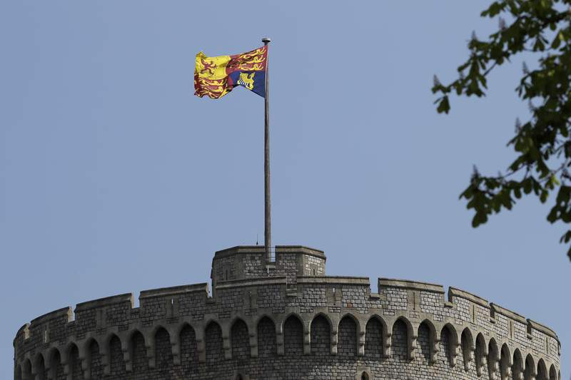 FILE - In this file photo dated Wednesday, April 21, 2021, The Royal Standard flies above Windsor Castle in Windsor, England.  Buckingham Palace said Thursday June 3, 2021, that Queen Elizabeth II will meet U.S. President Joe Biden at Windsor Castle on the final day of the June 11-13 visit to the U.K. for the Group of Seven leaders' summit next week.(AP Photo/Kirsty Wigglesworth, FILE)