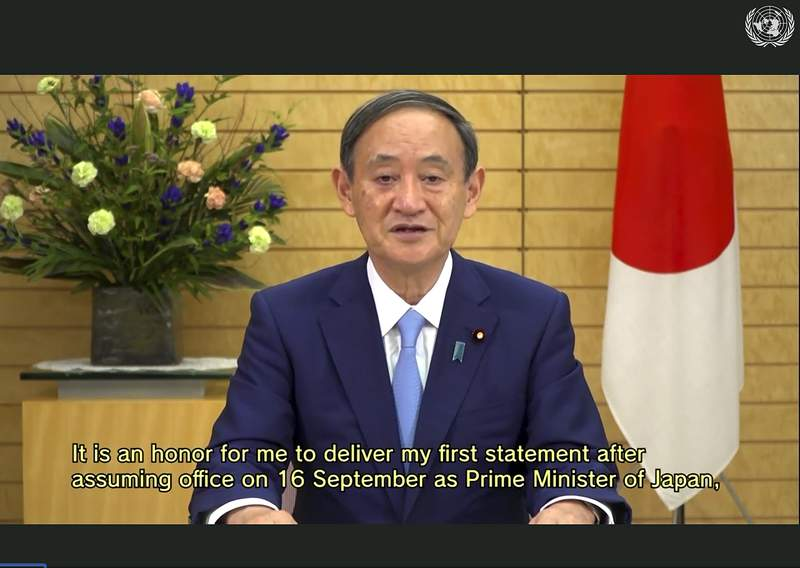 RETRANSMISSION TO CORRECT DATE - In this photo made from UNTV video, Suga Yoshihide, Prime Minister of Japan, speaks in a pre-recorded message which was played during the 75th session of the United Nations General Assembly, Friday, Sept. 25, 2020, at UN Headquarters. (UNTV Via AP )