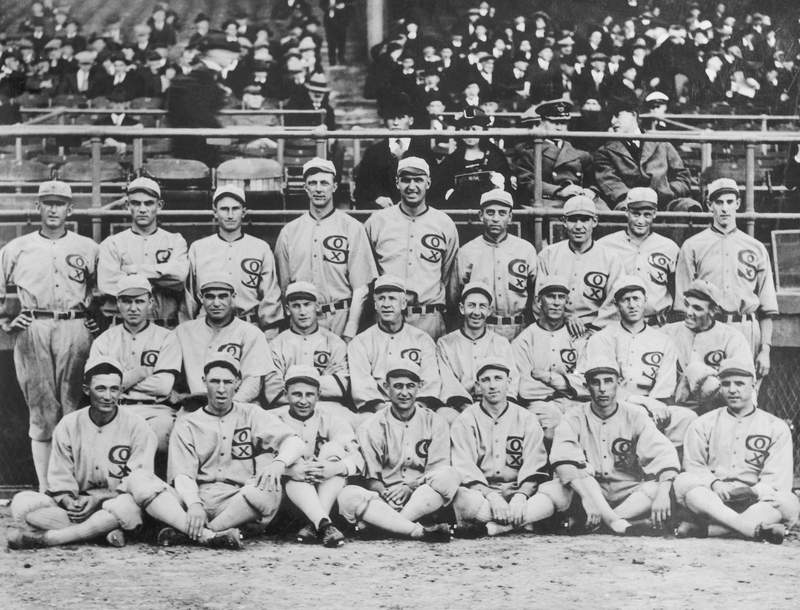 """Group shot of the 1919 White Sox. They would after this year be known as the """"Black Sox Scandal"""" team, due to the allegation that eight members of the team accepted bribes to lose the 1919 World Series to the Cincinnati Reds. These eight players, pitchers Eddie Cicotte and Claude """"Lefty"""" Williams, first baseman Charles """"Chick"""" Gandil, shortstop Charles """"Swede""""Risberg, third baseman George """"Buck"""" Weaver, outfielders Joe """"Shoeless Joe"""" Jackson and Oscar """"Happy"""" Felsch, and pinch hitter Fred McMullin, were banned from the game of baseball for life."""