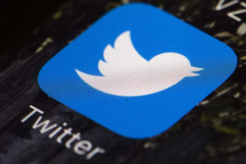 FILE - This April 26, 2017, file photo shows the Twitter app icon on a mobile phone in Philadelphia. Twitter will begin to label and in some cases remove doctored or manipulated photos, audio and videos that are designed to mislead people. The company said Tuesday, Feb. 4, 2020, that the new rules prohibit sharing synthetic or manipulated material that's likely to cause harm. (AP Photo/Matt Rourke, File)