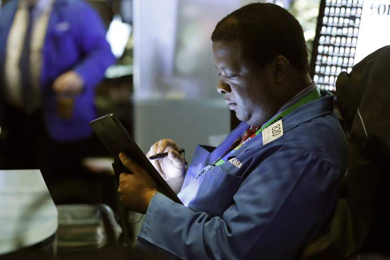 Trader Thomas Lee works on the floor of the New York Stock Exchange, Tuesday, March 10, 2020. T=Stocks, Treasury yields and oil are clawing back some of the plunge they took a day before, when the S&P 500 had its worst drop in more than a decade. (AP Photo/Richard Drew)