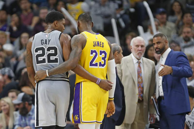 Rudy Gay #22 of the San Antonio Spurs and LeBron James #23 of the Los Angeles Lakers talk during a timeout at AT&T Center on October 27 , 2018  in San Antonio, Texas. (Photo by Ronald Cortes/Getty Images)