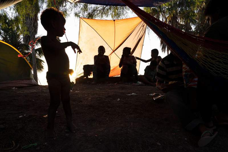 Mexican migrants pass time in an encampment in Matamoros, Tamaulipas, as they wait their turn to seek asylum in the U.S. on Oct. 13, 2019. (Credit: Verónica G. Cárdenas for The Texas Tribune/ProPublica)