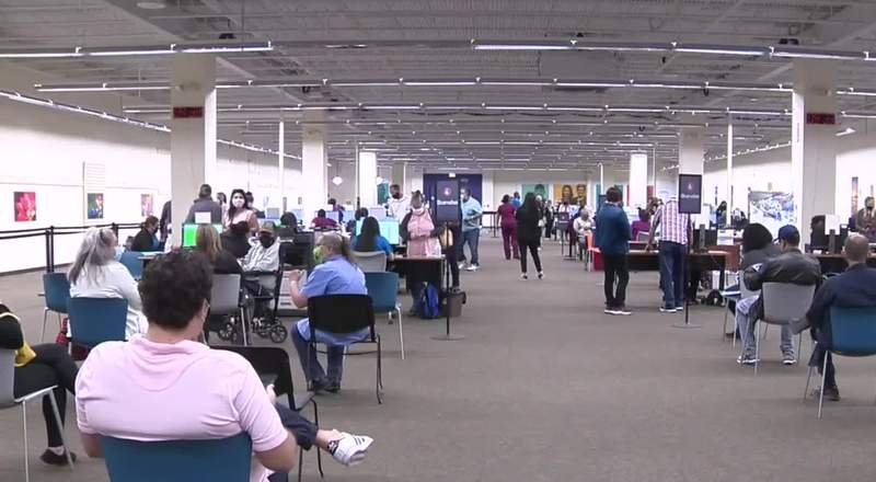 People wait to get their COVID-19 vaccine at the Wonderland of Americas at an event hosted by University Health.