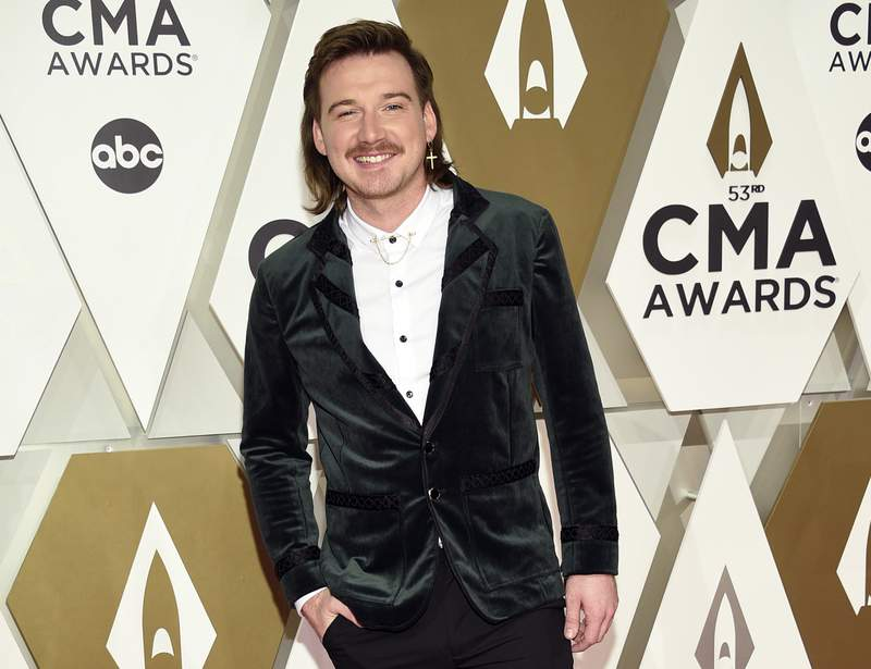 """FILE - Morgan Wallen arrives at the 53rd annual CMA Awards on Nov. 13, 2019, in Nashville, Tenn.   Wallen said it was ignorant of him to use a racial slur. In his first interview in six months, Wallen talked to Michael Strahan on ABC's Good Morning America."""" on Friday, July 23, 2021.    (Photo by Evan Agostini/Invision/AP, File)"""