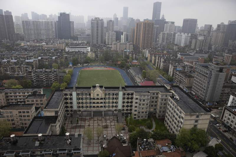 A view of the city of Wuhan taken from a quarantine hotel in central China's Hubei province on Monday, March 30, 2020. Shopkeepers in the city at the center of China's virus outbreak were reopening Monday but customers were scarce after authorities lifted more of the anti-virus controls that kept tens of millions of people at home for two months. (AP Photo/Ng Han Guan)