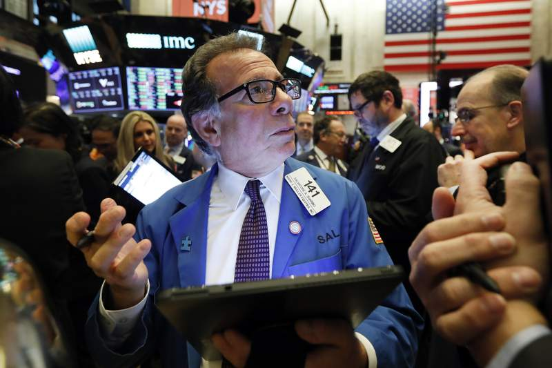 FILE - In this Dec. 13, 2019, file photo trader Sal Suarino works on the floor of the New York Stock Exchange. The U.S. stock market opens at 9:30 a.m. EST on Wednesday, Jan. 29, 2020. (AP Photo/Richard Drew, File)