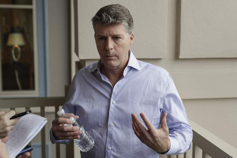 FILE - Hal Steinbrenner talks with reporters during a baseball owners meeting in Orlando, Fla., in this Wednesday, Feb. 5, 2020, file photo. Yankees owner Hal Steinbrenner vowed to keep manager Aaron Boone, general manager Brian Cashman and the core of his team, shaking off a crushing loss to the Los Angeles Angels in which New York wasted a four-run, ninth-inning lead. Steinbrenner spoke with reporters Thursday, July 1, 2021, the morning after the 11-8 defeat. (AP Photo/John Raoux, File)
