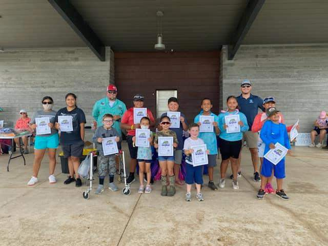 Compass Rose Public Schools Annual Youth Bank Fishing Tournament participants on Saturday, Aug. 28.