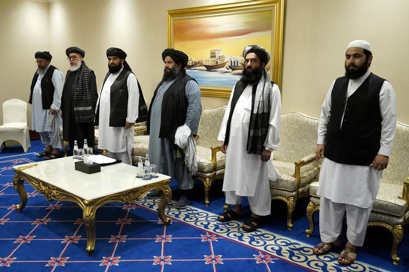 Members of the Taliban's peace negotiation team meet with Secretary of State Mike Pompeo amid talks between the Taliban and the Afghan government, Saturday, Nov. 21, 2020, in Doha, Qatar. (AP Photo/Patrick Semansky, Pool)