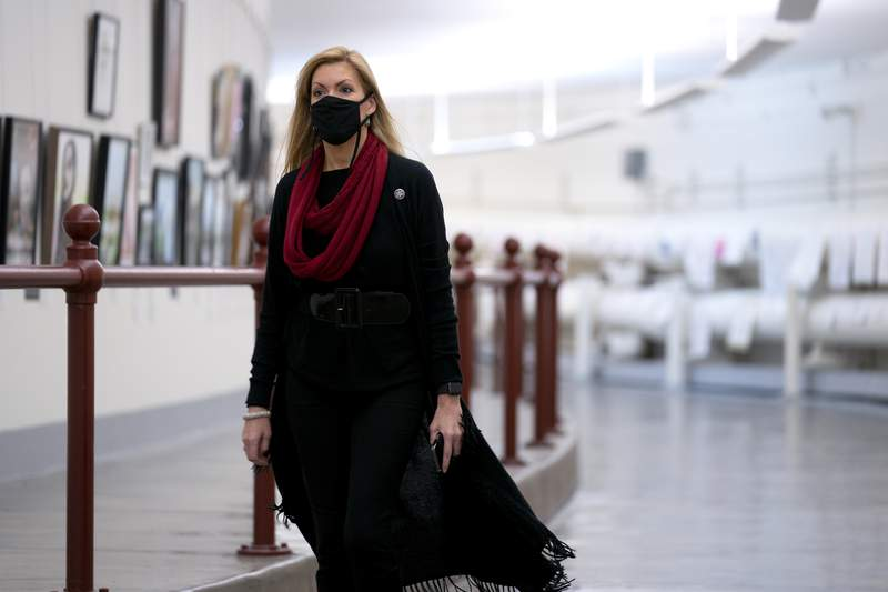 Rep. Beth Van Duyne (R-TX) wears a protective mask while walking through the Canon Tunnel to the U.S. Capitol on January 12, 2021 in Washington, DC. (Photo by Stefani Reynolds/Getty Images)