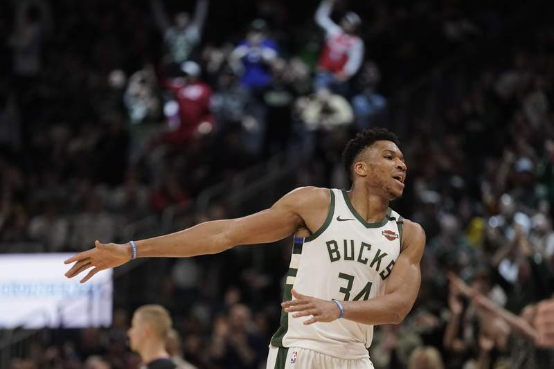 Milwaukee Bucks' Giannis Antetokounmpo reacts after making a three-point basket during the second half of an NBA basketball game against the Philadelphia 76ers Saturday, Feb. 22, 2020, in Milwaukee. The Bucks won 119-98. (AP Photo/Morry Gash)