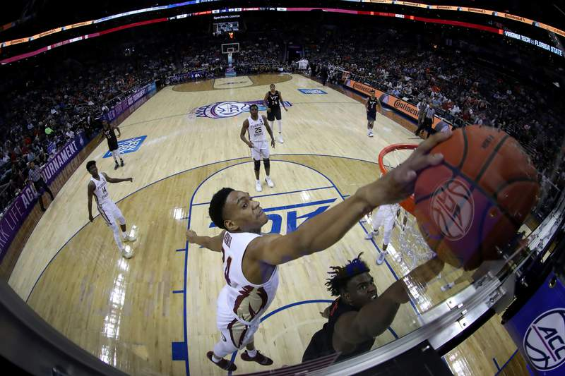 CHARLOTTE, NORTH CAROLINA - MARCH 14: Devin Vassell #24 of the Florida State Seminoles blocks a shot against the Virginia Tech Hokies during their game in the quarterfinal round of the 2019 Men's ACC Basketball Tournament at Spectrum Center on March 14, 2019 in Charlotte, North Carolina. (Photo by Streeter Lecka/Getty Images)
