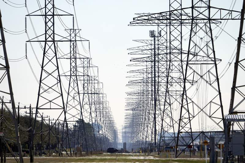 FILE - This Tuesday, Feb. 16, 2021, file photo shows power lines in Houston. (AP Photo/David J. Phillip, File)