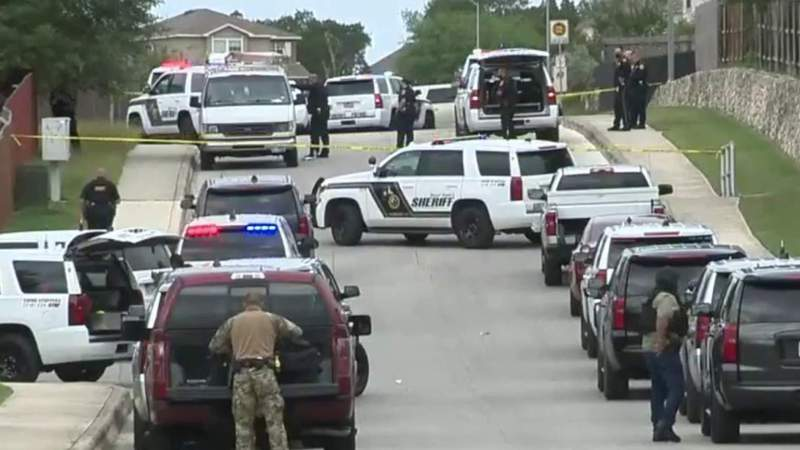 Authorities ID man found dead in home where son barricaded himself