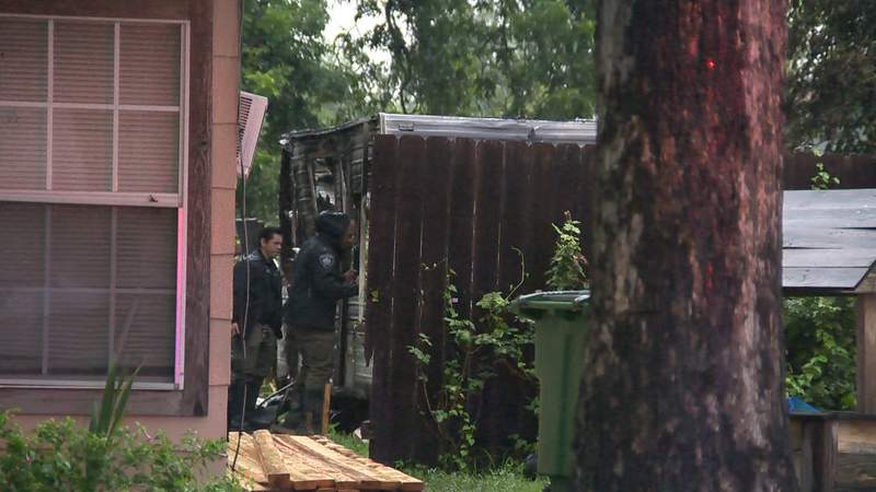 Investigators at the scene of a fire on Friday, July 9, 2021, in the 200 block of Readwell Drive on the East Side.