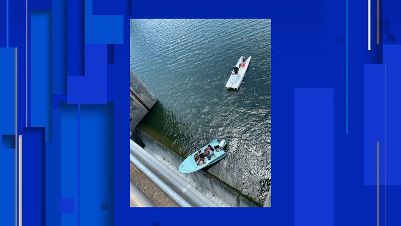 Boaters near Austin were rescued after coming very close to their vessel tipping over a dam Thursday afternoon, according to Austin-Travis County EMS.