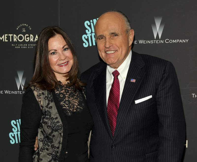 """FILE - In this Tuesday, April 12, 2016, file photo, Judith Giuliani, left, and former New York mayor Rudy Giuliani, right, attend the premiere of """"Sing Street"""" at Metrograph, in New York. Giuliani and his third wife, Judith, have reached a settlement in a yearslong court battle that exposed details about their luxurious lifestyle, The New York Times reported on Tuesday, Dec. 10, 2019. (Photo by Andy Kropa/Invision/AP, File)"""