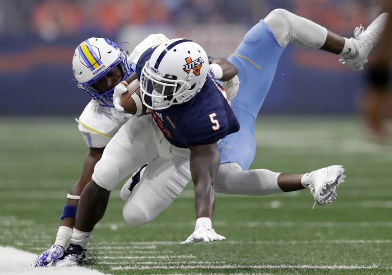 UTSA running back Jalen Rhodes (5) is hit by Southern defensive back Andrea Augustine during the first half of an NCAA college football game, Saturday, Sept. 16, 2017, in San Antonio. (AP Photo/Eric Gay)