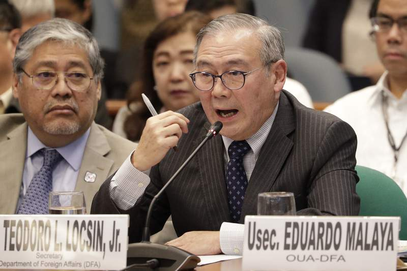 FILE - In this Feb. 6, 2020, file photo, Philippine Secretary of Foreign Affairs Teodoro Locsin Jr. gestures during a senate hearing in Manila, Philippines. The Philippines on Tuesday notified the United States of its intent to terminate a major security pact allowing American forces to train in the country in the most serious threat to the countries treaty alliance under President Rodrigo Duterte. (AP Photo/Aaron Favila, File)