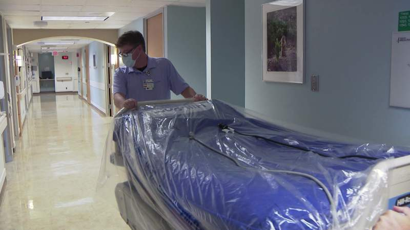 Workers at St. Luke's Hospital in the Texas Medical Center in Houston wheel a hospital bed as teams prepare to handle more coronavirus patients June 30, 2020.