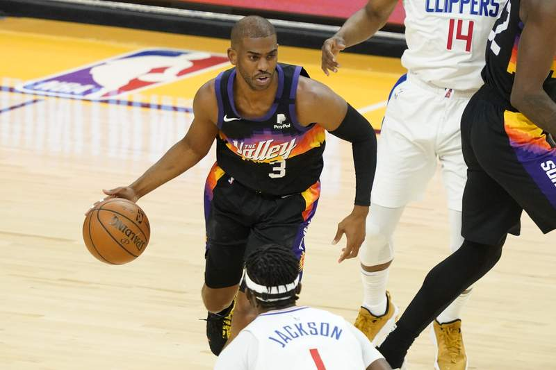 Phoenix Suns guard Chris Paul (3) looks to pass against the Los Angeles Clippers during the first half of game 5 of the NBA basketball Western Conference Finals, Monday, June 28, 2021, in Phoenix. (AP Photo/Matt York)