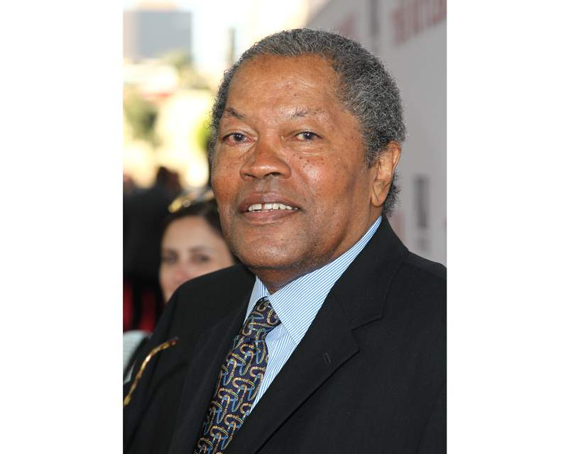 """FILE - In this Aug. 12, 2013 file photo, Clarence Williams III arrives at the Los Angeles premiere of """"Lee Daniels' The Butler"""" at the Regal Cinemas L.A. Live Stadium. Williams died Friday at his home in Los Angeles after a battle with colon cancer, his manager Allan Mindel said Sunday, June 6, 2021. He was 81. (Photo by Matt Sayles/Invision/AP, File)"""