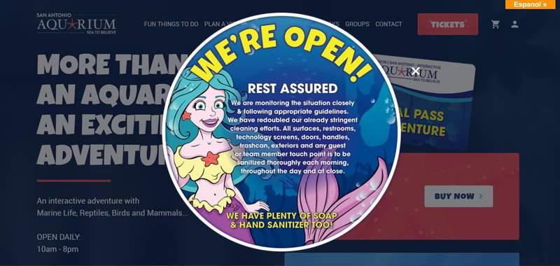 The website of the San Antonio Aquarium saying it's open despite an emergency declaration banning social gatherings of 10-plus people.