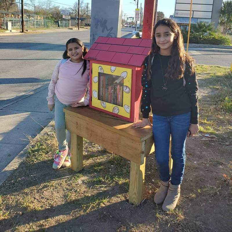 Ruby (left) and Bella Cortez at a free community library for kids on the South Side