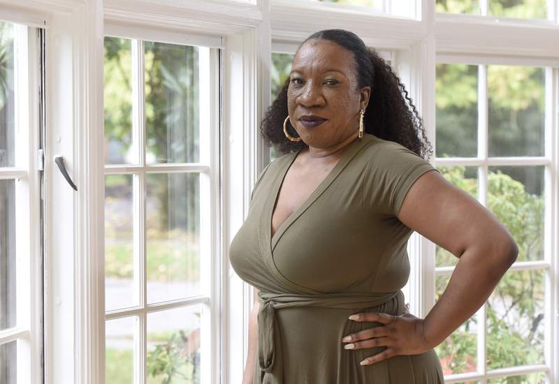 Tarana Burke, founder and leader of the #MeToo movement, stands in her home in Baltimore on Oct. 13, 2020. A coalition of three groups vital to the #MeToo movement is collaborating on an initiative to focus on a population that has often felt left out of the conversation: Black survivors of sexual violence. It's been more than three years since the #MeToo movement exploded into view, but Burke, the activist who gave the movement its name, says concrete change has been incremental at best  even more so for the Black community. (AP Photo/Steve Ruark, file)
