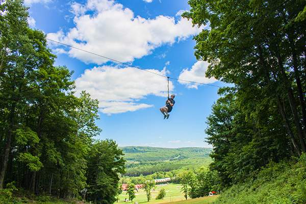 Stock photo of person ziplining in Petoskey, Michigan.