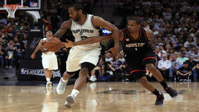 SAN ANTONIO, TX - MAY 01:  Kawhi Leonard #2 of the San Antonio Spurs dribbles the ball against Trevor Ariza #1 of the Houston Rockets in the second quarter during Game One of the NBA Western Conference Semi-Finals at AT&T Center on May 1, 2017 in San Antonio, Texas.  NOTE TO USER: User expressly acknowledges and agrees that, by downloading and or using this photograph, User is consenting to the terms and conditions of the Getty Images License Agreement.  (Photo by Ronald Martinez/Getty Images)