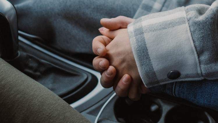 Holding hands.