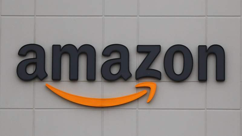FILE - This April 1, 2020 file photo shows the Amazon DTW1 fulfillment center in Romulus, Mich., April 1, 2020.  Amazon says executive Wilke, who oversees the companys retail business, will retire early in 2021. He will be replaced by Dave Clark, who runs Amazon's warehouses and delivery network. Wilke has been at Amazon for more than two decades. (AP Photo/Paul Sancya)