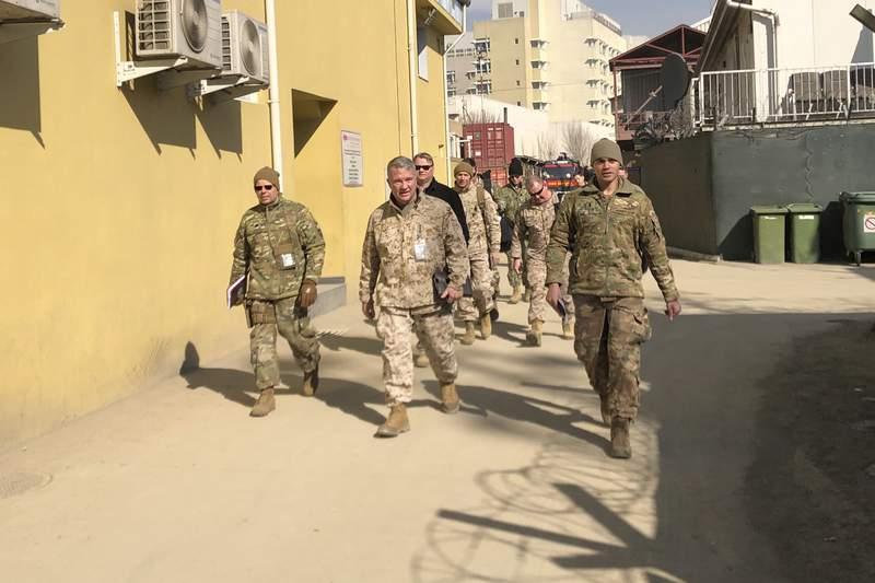 Marine Gen. Frank McKenzie, center, top U.S. commander for the Middle East, makes an unannounced visit, Friday, Jan. 31, 2020 in Kabul, Afghanistan. (AP Photos/Lolita Baldor)